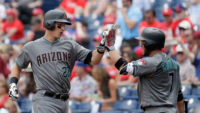 Arizona Diamondbacks' Jake Lamb, left, celebrates with Welington Castillo, right, after Lamb's two-run home run off Philadelphia Phillies starting pitcher Jeremy Hellickson during the first inning of a baseball game, Monday, June 20, 2016, in Philadelphia.