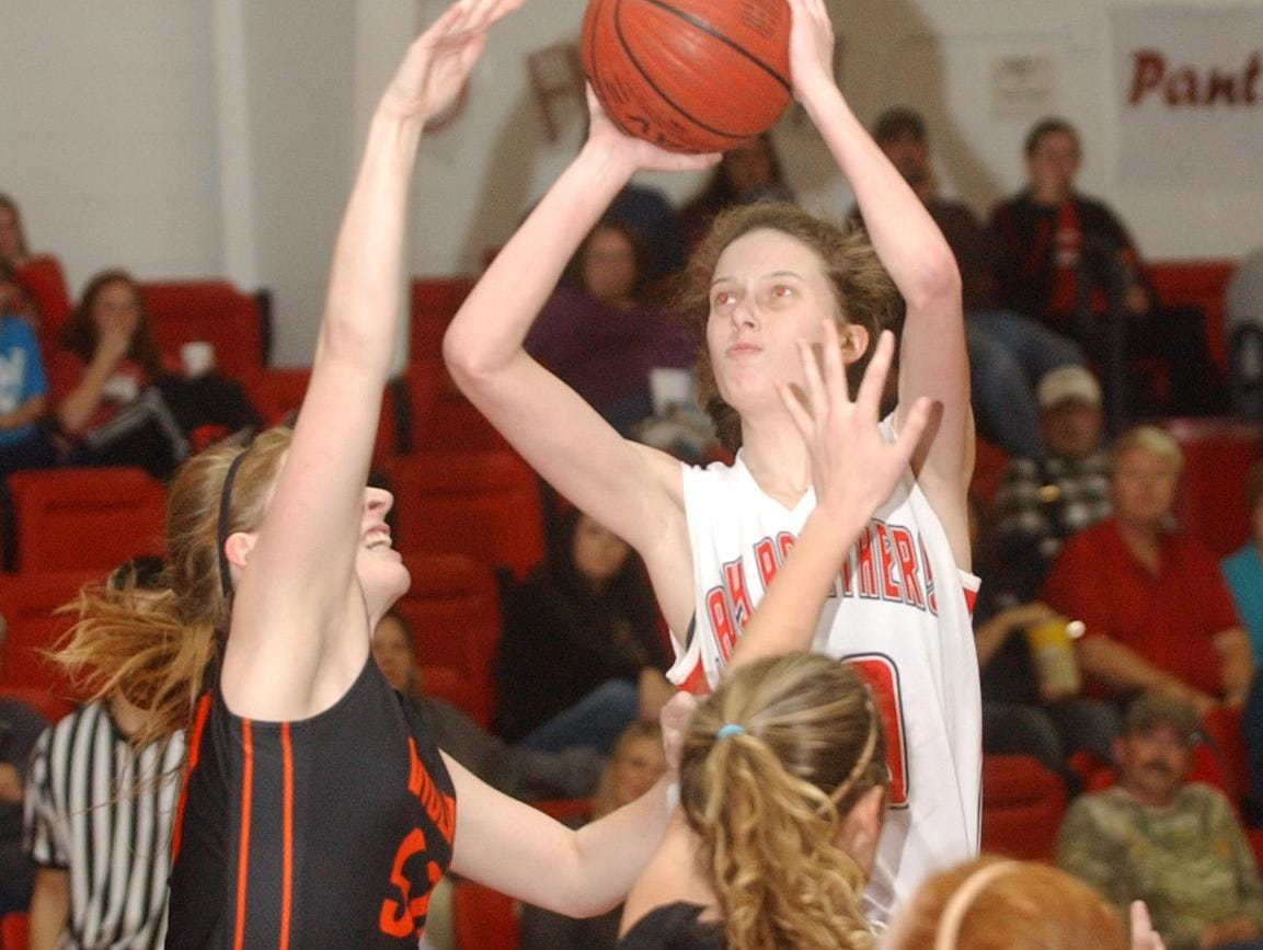 Norfork's Marleigh Dodson shoots over Viola's Amanda Martin, left, and Destiny Crawford during the Lady Panthers' 55-30 victory over the Lady Longhorns on Tuesday night at Norfork.