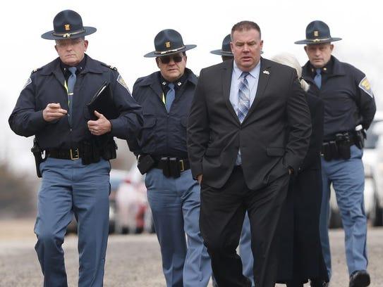 Indiana State Police Superintendent Doug Carter, far