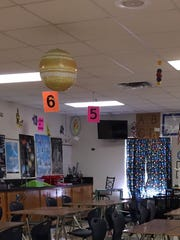 Planets hang from the ceiling and the periodic table of elements will greet students inside Lee Middle School's sixth-grade science classroom of Kim Baucom.