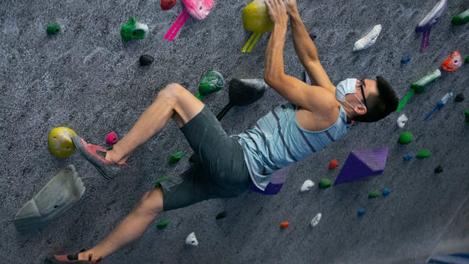 Richie Winter of Tempe, Arizona, climbs on the bouldering wall at Focus Climbing Center in Mesa, Arizona, on their first day after re-opening, on May 26, 2020. A federal judge has ordered gyms can open in Michigan June 25, despite an order from Gov. Gretchen Whitmer that they remain closed because of the coronavirus pandemic.