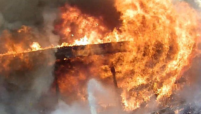 A photo for firefighters fighting a deadly blaze early Thursday in Knightstown