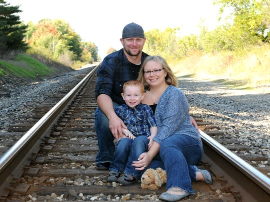 Tom, Christine and Deegan Weiler. Christine is pregnant with a girl and is due in April.