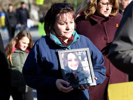 Lisa Yakomin of Woodcliff Lake carries a framed photo of Parkland, Fla., shooting victim Alyssa Alhadeff, the 14-year-old soccer star who was a member of Temple Emanuel when she lived in Woodcliff Lake from 2010-14. About 150 people marched from Dorchester Elementary School to Temple Emanuel in Woodcliff Lake on Sunday, March 25, 2018, as part of the national March for Our Lives movement.