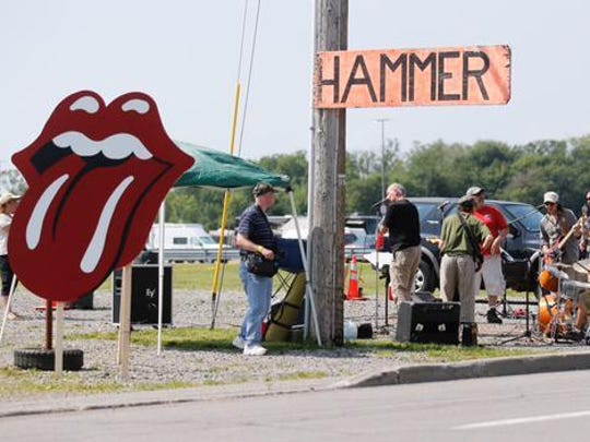 A band plays outside the Rolling Stones concert at Ralph Wilson Stadium in Orchard Park on Saturday as traffic backs up nearby.
