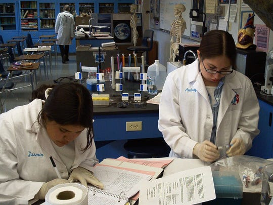 Yasmin Cervantes, left, and Audrey Hernandez are busy on DNA protocol work on the bi-state sage grouse as part of the Yerington High School DNA class that participated in a sage grouse project in the early 2000s.