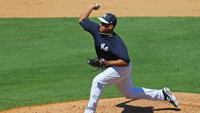 Ernesto Frieri pitches for the New York Yankees during spring training last year.