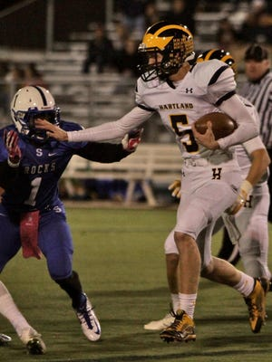 Quarterback Noah Marshall threw a pick-6 early, but then rushed for two touchdowns and threw for two more in Hartland's 34-12 win at Grosse Pointe North.