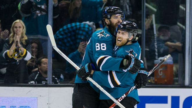 San Jose Sharks defenseman Brent Burns (88) celebrates with center Joe Thornton (19) after scoring against the Los Angeles Kings in the second period at SAP Center at San Jose.