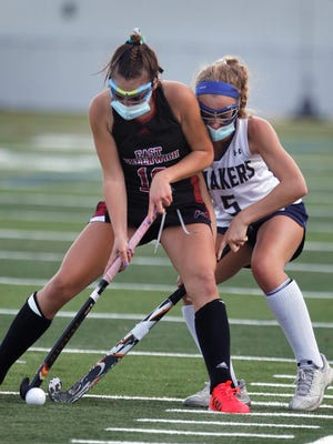 The Avengers' Alex Mega, left, who scored four goals, boxes out the Quakers' Caroline Powell during Monday's game at Moses Brown.