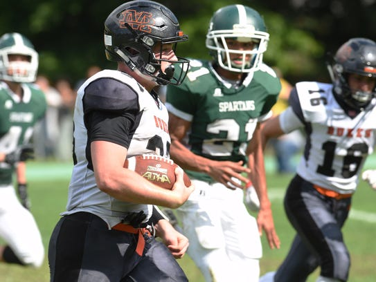 Marlboro's Phillip DeSantis takes the ball down the
