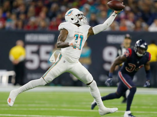 HOUSTON, TX - OCTOBER 25:  DeVante Parker #11 of the Miami Dolphins makes a one handed catch in the fourth quarter against the Houston Texans at NRG Stadium on October 25, 2018 in Houston, Texas.  (Photo by Bob Levey/Getty Images)
