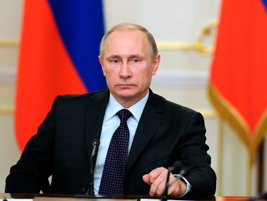 Russian President Vladimir Putin heads a cabinet meeting
