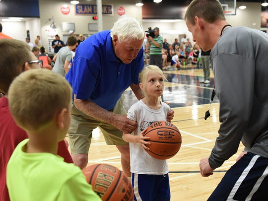Hall of Fame coach, Bob Knight, works with Shelby Begeman during the legends basketball clinic as Allan Bertram assists at the Sanford Pentagon in Sioux Falls, S.D., Saturday, June 11, 2016.