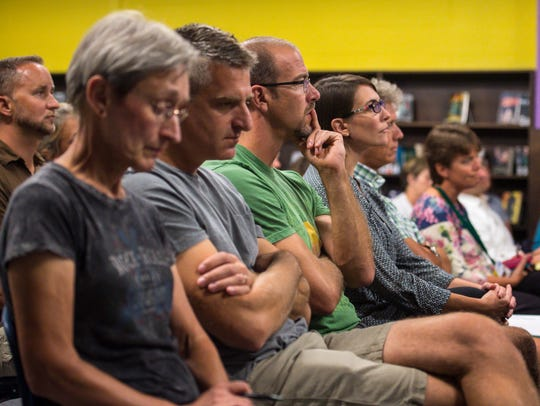 Audience members listen as the South Burlington School