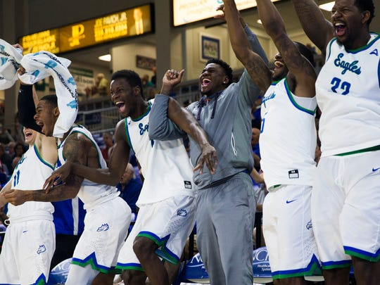 The Florida Gulf Coast University men's basketball team jump up from their seats after Florida Gulf Coast University junior, Joshua Ko, makes a shot during the game against Florida National University at Alico Arena in Estero, Fla. on Thursday, December 22, 2016. The Eagles beat Florida National University, 107 to 50.