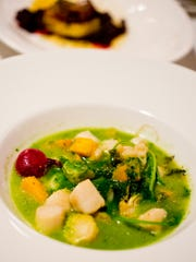 Bay scallops appetizer with vegetables and parsley.
