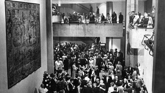 Guests mill about the lobby of Clowes Memorial Hall during its grand opening celebration in 1963.