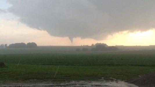 A possible tornado churns near Caleb Hamer's farm in Black Hawk County on Sunday.