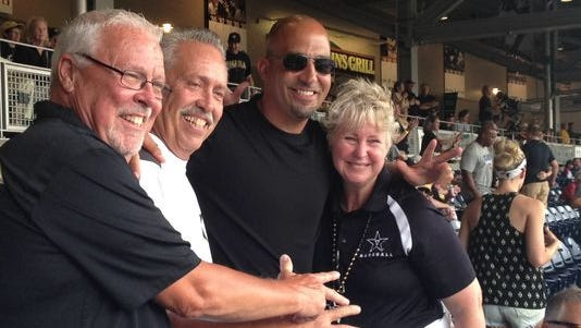 Former Vanderbilt football coach James Franklin takes photos with fans before the Commodores game with Louisville at the College World Series.