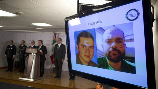 Federal officials display photographs of Fernando Sanchez Arellano during a press conference in Mexico City.