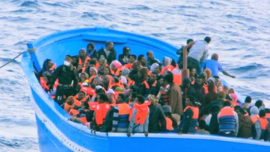 A photo taken from video show migrants who were rescued by the Italian navy.