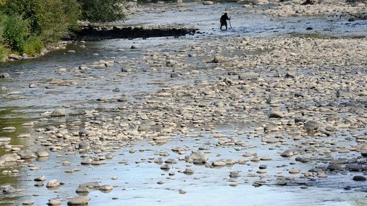 The Truckee River's waters are so low a man was able to cross it on Sept. 23, just below Both Bridge.