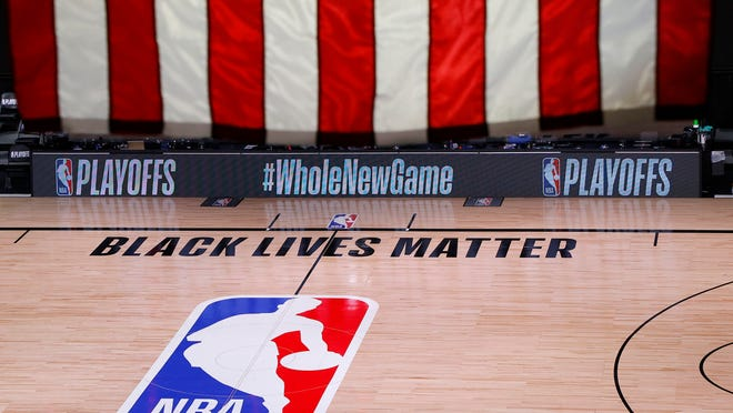 An empty court and bench are shown following the scheduled start time of Game 5 of an NBA basketball first-round playoff series, Wednesday, Aug. 26, 2020, in Lake Buena Vista, Fla. All three NBA playoff games scheduled for Wednesday and Thursday were postponed, with players around the league choosing to boycott in their strongest statement yet against racial injustice.
