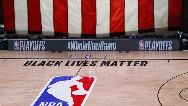 An empty court and bench are shown following the scheduled start time of Game 5 of the Bucks/Magic playoff series on Wednesday in Lake Buena Vista, Fla.