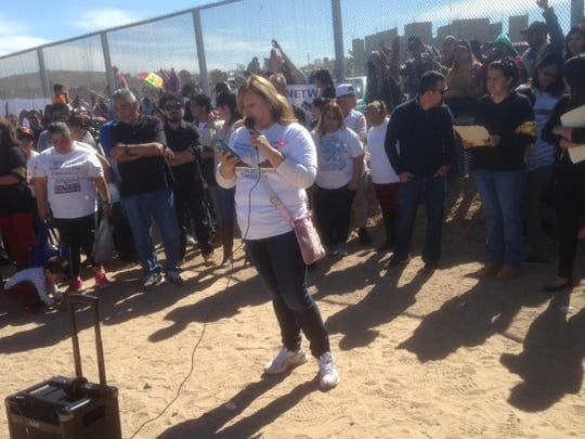Margarita Arvizu talks about the deportation several years ago of her undocumented husband at a rally Monday in Sunland Park, N.M. Behind her, stood people who took part in the rally from the Mexican side of the border fence to bring attention to immigration problems as Pope Francis is scheduled to visit Juárez on Wednesday.