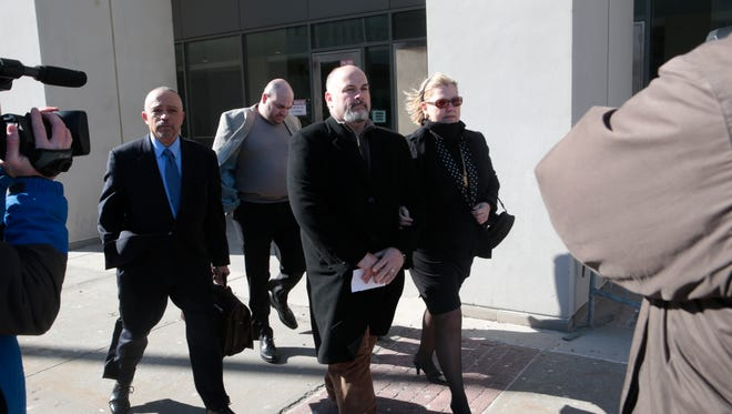 Attorney Randolph McLaughlin leaves Westchester County Courthouse in White Plains with his clients, Robert Borelli and Joseph Felice, and Felice's wife, Patricia Sclafani, after attending a court appearance of NYPD Officer Brendan Cronin on March 12, 2015. Cronin allegedly shot Felice and Borelli in Pelham in April 2014.