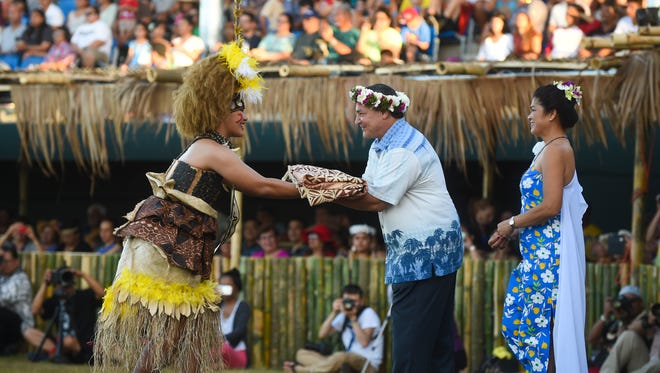 Gov. Eddie Baza Calvo receives a gift from American Samoa during the 12th Festival of Pacific Arts Guam 2016 at Paseo Stadium in Hagatna on May 22.