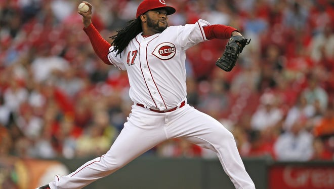 Reds starting pitcher Johnny Cueto delivers a pitch against the Giants on May 14.
