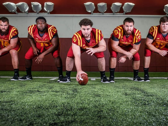 Members of the Iowa State offensive line, from left,