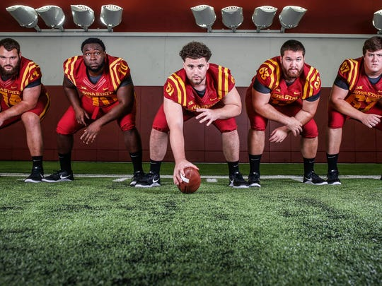 Members of the Iowa State offensive line, from left, Bryce Meeker, Oge Udeogu, Julian Good-Jones, Robby Garcia and Jake Campos pose for a photo during the Iowa State football team media day at Bergstrom Indoor Practice Facility on the Iowa State campus in Ames on Thursday, Aug. 3, 2017.