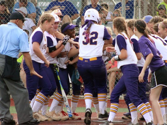 635976477340859869-ASH-junior-Carrie-Boswell-32-is-mobbed-at-home-plate-following-her-homerun-against-the-Live-Oak-Lady-Eagles.JPG