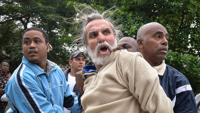 A man is arrested during a demonstration by the Ladies in White movement and other members of the Cuban opposition during Human Rights Day in downtown Havana on Dec. 10.