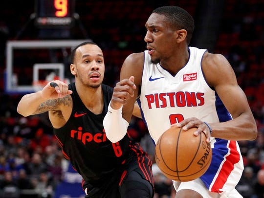 Detroit Pistons guard Langston Galloway (9) gets defended by Portland Trail Blazers guard Shabazz Napier (6) during the second quarter at Little Caesars Arena, Monday, Feb. 5, 2018.