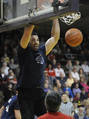 Former Lexington All-American Jamie Feick, a two-time Big Ten rebound leader and six-year NBA pro, dunks in the 35th anniversary News Journal Classic alumni game in 2013. Feick will be part of the alumni game that celebrates the 40th anniversary of the Classic.