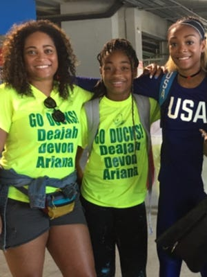 U.S. Olympian Deajah Stevens, right, of Tarrytown with her mother, Lakia Perkins and sister, Ameera Shaban, at the Olympic track stadium in Brazil.