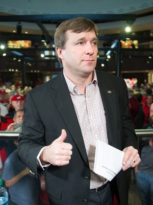 Georgia head football coach Kirby Smart gives a thumbs up after finishing an interview during National Signing Day.