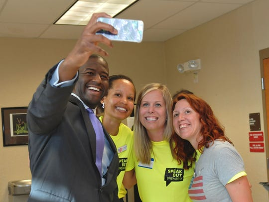 "Taking photos with members of Speak Out Brevard. Tallahassee Mayor Andrew Gillum, a Democrat who is running for Florida Governor, was one of the speakers at a  packed ""People's Town Hall"", organized by Speak Out Brevard, held at Viera high school auditorium Tuesday evening."