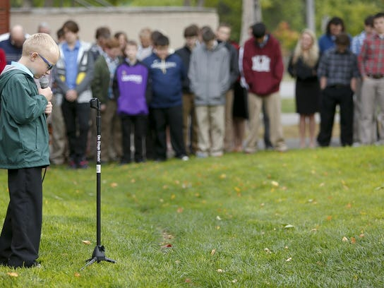 A Foothills Community Christian School student prays during a global day of student prayer.