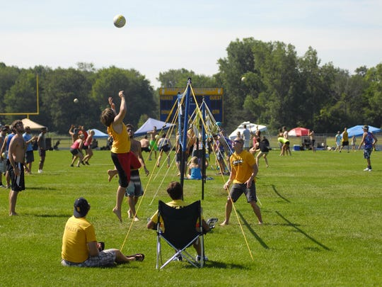 Players take to the grass Sunday, July 26, during the annual Volleygrass volleyball tournament at Port Huron Northern.
