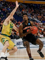 Two Jersey boys: Notre Dame guard Matt Farrell (5) pressures Princeton guard Amir Bell (5)  during the NCAA Tournament.