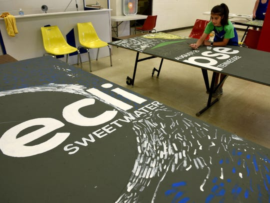 Gracie Hart works on a mural for the Sweetwater celebration
