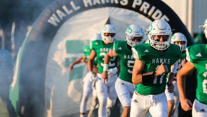 The Wall Hawks run onto the field the game against Monahans on Friday, Sept. 1, 2017, at  Hawk Stadium in Wall. The Hawks dominated Monahans 50-13 for a statement-making win.