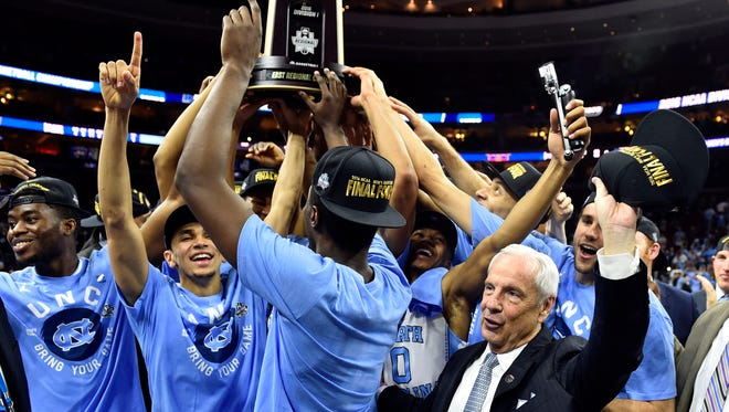 North Carolina head coach Roy Williams celebrates with his team on Sunday after defeating Notre Dame in the championship game in the East regional of the NCAA Tournament at Wells Fargo Center in Philadelphia, Pennsylvania. Carolina won 88-74.