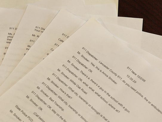 FILE – This file photo shows copies of 911 call transcripts