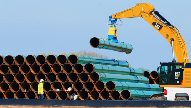 In this May 9, 2015, file photo, pipes for the proposed Dakota Access Pipeline are stacked at a staging area in Worthing, S.D.